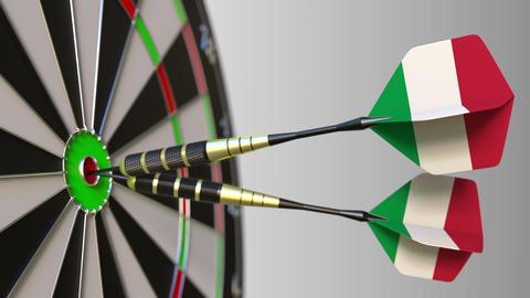 Italian national achievement. Flags of Italy on darts hitting bullseye Live Action