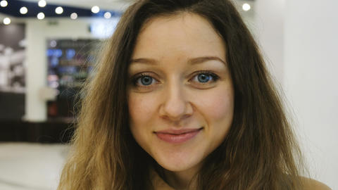 Portrait of a beautiful smiling girl close-up in a mall Footage
