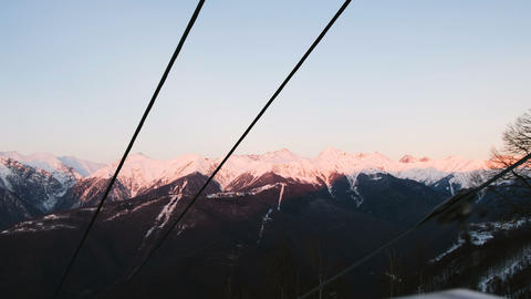 Sunset in the mountains, view from the open chair lift Footage