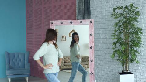 Joyful woman checking her body shape in mirror Footage