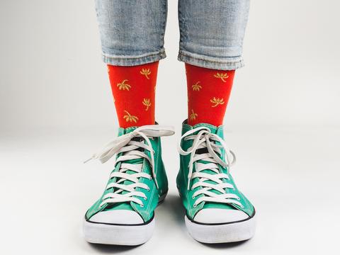 Stylish sneakers and funny, happy socks Fotografía