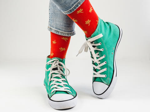 Stylish sneakers and funny, happy socks Photo
