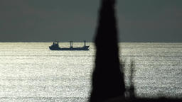 Ship along the ocean as a silhouette Footage