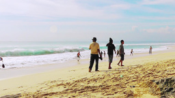 Tourists are walking along the surf line,Dreamland,Bali Footage