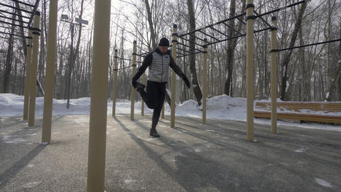 Young man training workout exercise on winter sports ground Footage