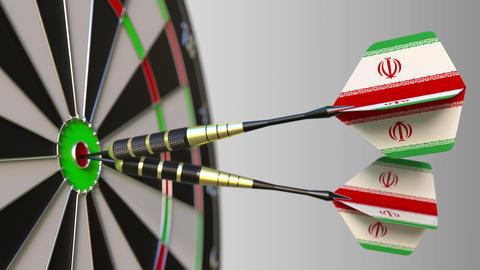 Iranian national achievement. Flags of Iran on darts hitting bullseye Footage