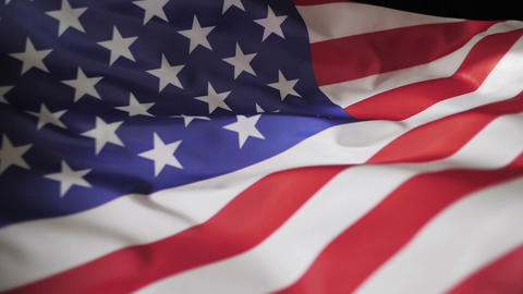 Flag of America in the wind on black background, slow motion Footage