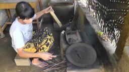 Woman is roasting coffee beans,Bali Videos de Stock