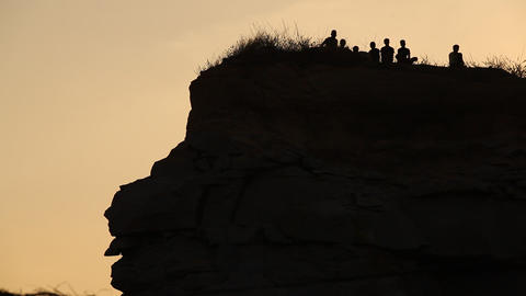 Silhouette of people on the hill Live Action