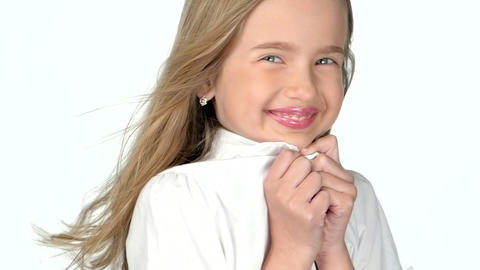 Teenage girl blonde smiling and posing on white background,slow motion Footage