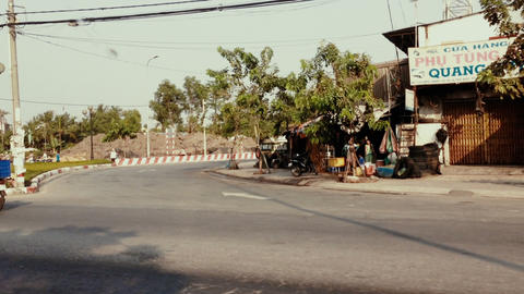 HOI AN, VIETNAM - JUNE 5, 2014: Vietnamese riding scooters on th Footage