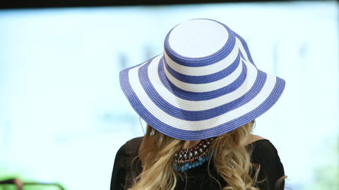 Girl in Blue and White Striped Hat Lifts Head up Archivo