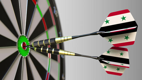 Syrian national achievement. Flags of Syria on darts hitting bullseye Live Action