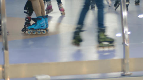 Teenagers ride on rollers at rollerdrome Footage
