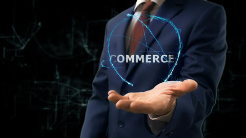 Businessman shows concept hologram Commerce on his hand Footage