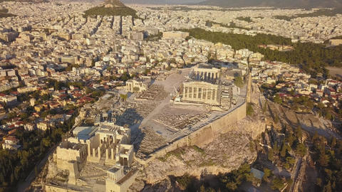 The Acropolis of Athens, Greece, with the Parthenon Temple during sunset (aerial Footage
