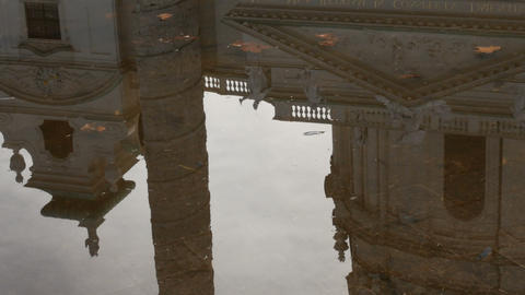 Church Karlskirche, Baroque style seen in reflection in a puddle, near Footage