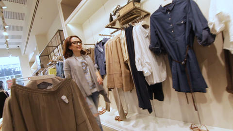 Girl Tries on Dress Showing Friends Asking Advice Archivo