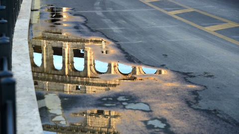 World famous Coliseum reflected in a puddle Live Action
