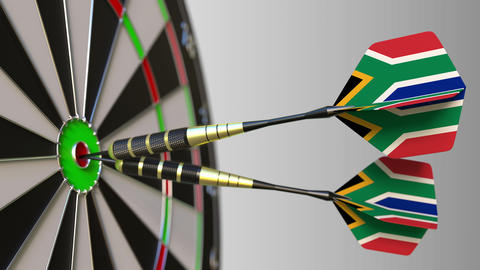 South African national achievement. Flags of the SAR on darts hitting bullseye Live Action