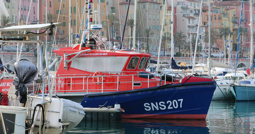French Blue And Orange Boat Rescuers At Sea Moored on The Harbor Image