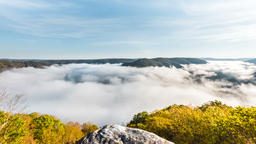 Timelapse, time lapse of floating, moving fog clouds during sunrise at Grandview Footage