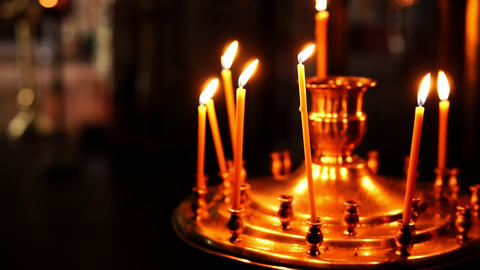 Golden Orthodox candle holder with burning candlesticks Footage