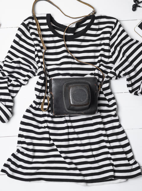 white cotton shirt in black stripes and an old vintage camera フォト