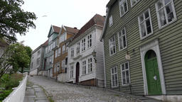 Norway Gamle Bergen old Nordic houses at an ascent with cobblestones Footage
