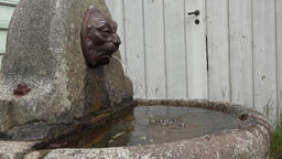 Norway Gamle Bergen gargoyle with water basin on old village square Footage
