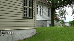 Norway Gamle Bergen wooden house walls with windows and a lawn Footage
