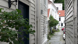Norway Bergen Skuteviken white wooden house walls and small alley Footage