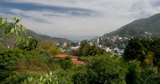 Establishing shot view through a mountain valley with lush tropical jungle and Footage