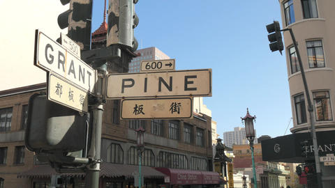 A stationary shot of the street sign for grant and Pine Street Live Action