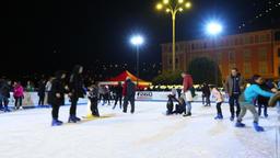 People enjoy skating on the ice rink Footage