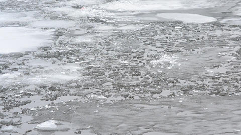 Blocks of melting ice floating on water surface with waves Footage