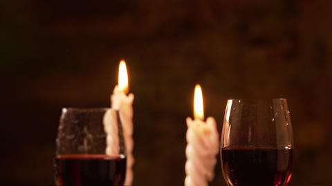 Person taking one of two glasses with red wine during... Stock Video Footage