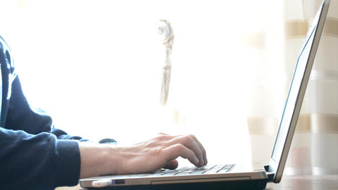 Hands of young slim man touch typing on laptop at home Footage
