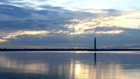 Time lapse of beautiful clouds at dawn with lighthouse Footage