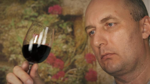 Middle aged tester with glass of red wine Footage