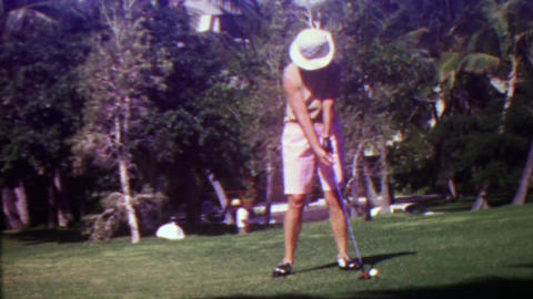 1963: Women golfer drives ball from 1st tee at golf course Footage