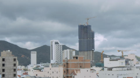 Motion Past Skyscraper in City at Hills Timelapse 영상물