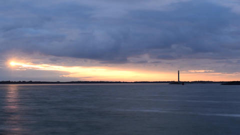 Time lapse of gorgeous sunrise with lighthouse Live Action