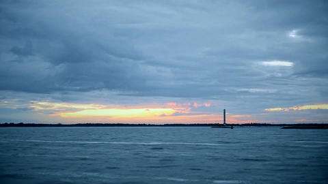 Time lapse of lighthouse with dramatic clouds Footage