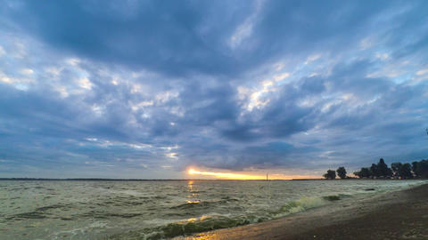 Dynamic time lapse with colorful clouds over water Footage