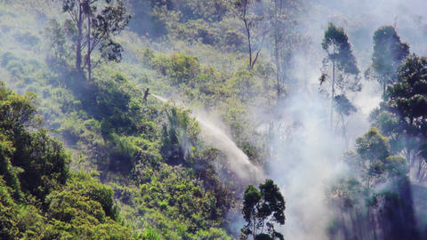 Firefighters Extinguishing A Forest Fire In Banos Ecuador Footage