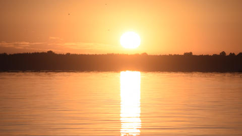 Sun rising over lake or river Footage