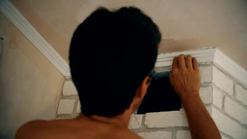 Craftsman mounting a polyurethane ceiling molding Live Action