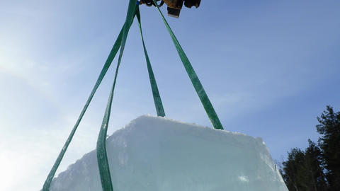 Giant ice cube hanging in the air with slings Footage