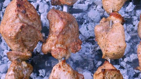 Shish kebab preparing on metal skewers Footage